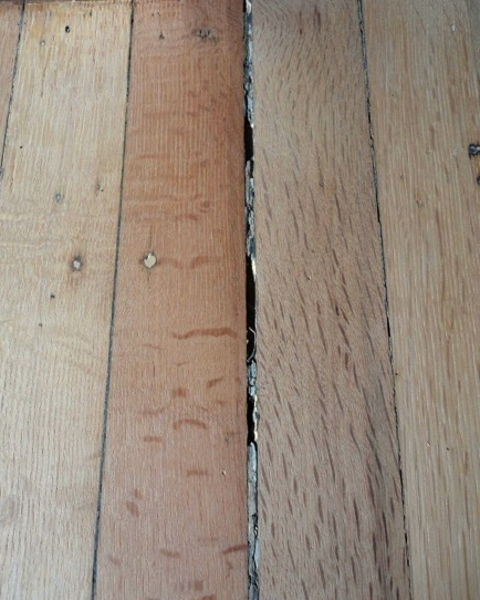 Problems with wood filler how not to fill gaps in for Wood floor expansion gap