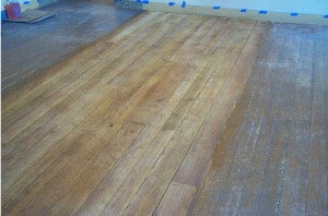 Layers Of Old Finish Were Removed From Both Floors Of The Historic Structure And The Wood Retained Its Natural Patina.
